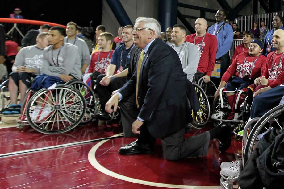 NBA Commissioner David Stern poses for a photograph with NBA/NWBA All-Star Wheelchair Classic players after the officially tip off of NBA All-Star Jam Session. Photo: James Nielsen, Chronicle / © Houston Chronicle 2013