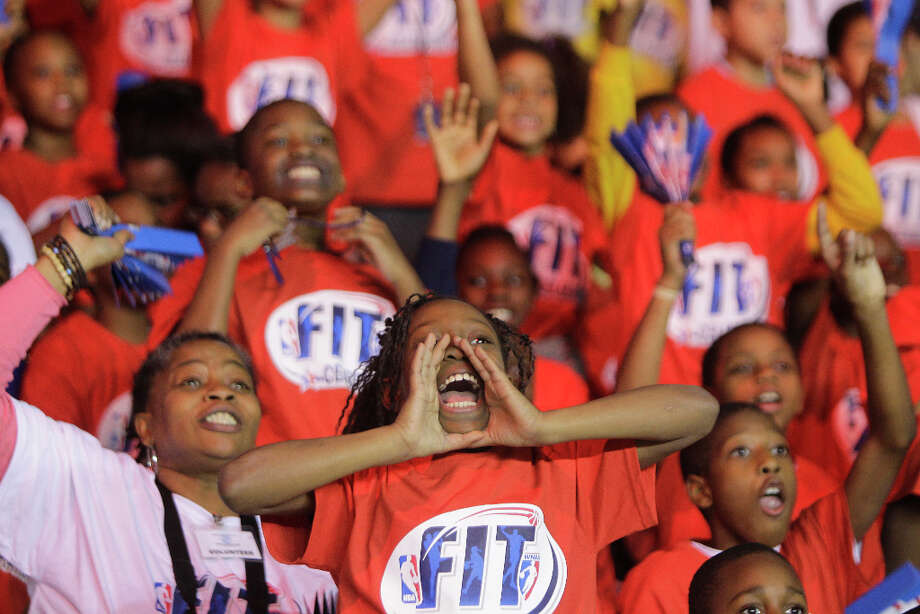 Alexis Berry, 10, center, yells among others from the  Morefield Boys & Girls Club during the NBA FIT All-Star Youth Celebration. Photo: Melissa Phillip, Houston Chronicle / © 2013 Houston Chronicle