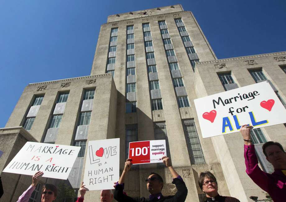 Nearly a dozen same-sex couples marched from the Harris County Clerk's Office to Houston City Hall after being denied  marriage licenses on Valentine's Day. Photo: J. Patric Schneider, Freelance / © 2013 Houston Chronicle