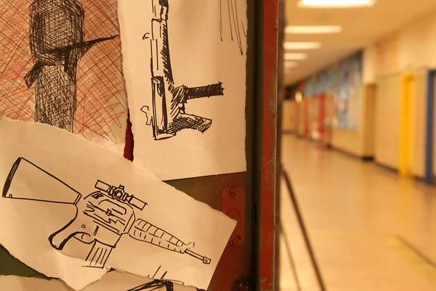 "A re-enactment in PBS' ""The Path to Violence"" shows a locker with drawings of guns. Photo: Alex Jouve, PBS"
