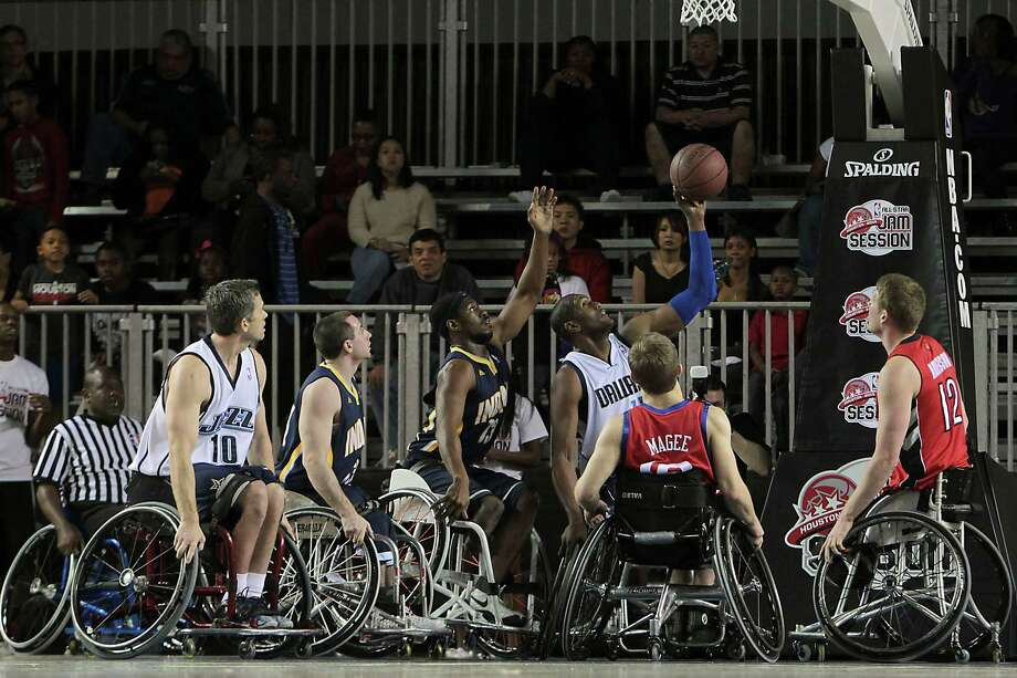 West All-Star Rodney Hawkins shoots the ball during the NWBA Wheelchair Classic. Photo: James Nielsen, Chronicle / © Houston Chronicle 2013
