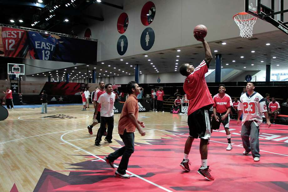 NBA All-Star Jam Session attendees play a game of basketball on one of the FIT courts during NBA All-Star weekend at the George R. Brown Convention Center. Photo: James Nielsen, Chronicle / © Houston Chronicle 2013