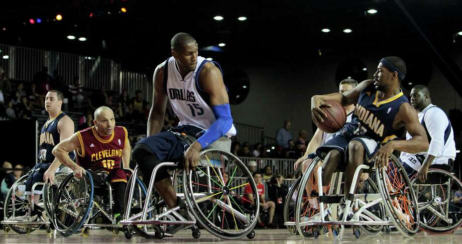 East All-Star Brian Bell right, moves the ball during the NWBA Wheelchair Classic All-Star Game at the NBA All-Star Jam Session. Photo: James Nielsen, Chronicle / © Houston Chronicle 2013