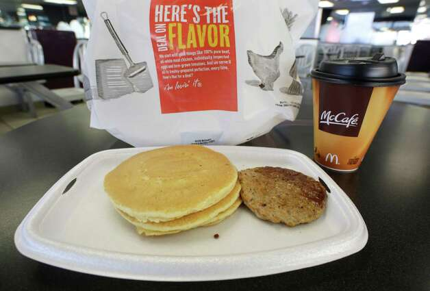 A McDonald's breakfast is arranged for an illustration Thursday, Feb. 14, 2013 at a McDonald's restaurant in New York. The pancakes and sausage are served on a foam tray and coffee is served in a foam cup. New York Mayor Michael Bloomberg, who has taken on smoking, sugary drinks and salt, talked about banning food packaging made from polystyrene foam from stores and restaurants in his annual State of the City address on Thursday. (AP Photo/Mark Lennihan) Photo: Mark Lennihan