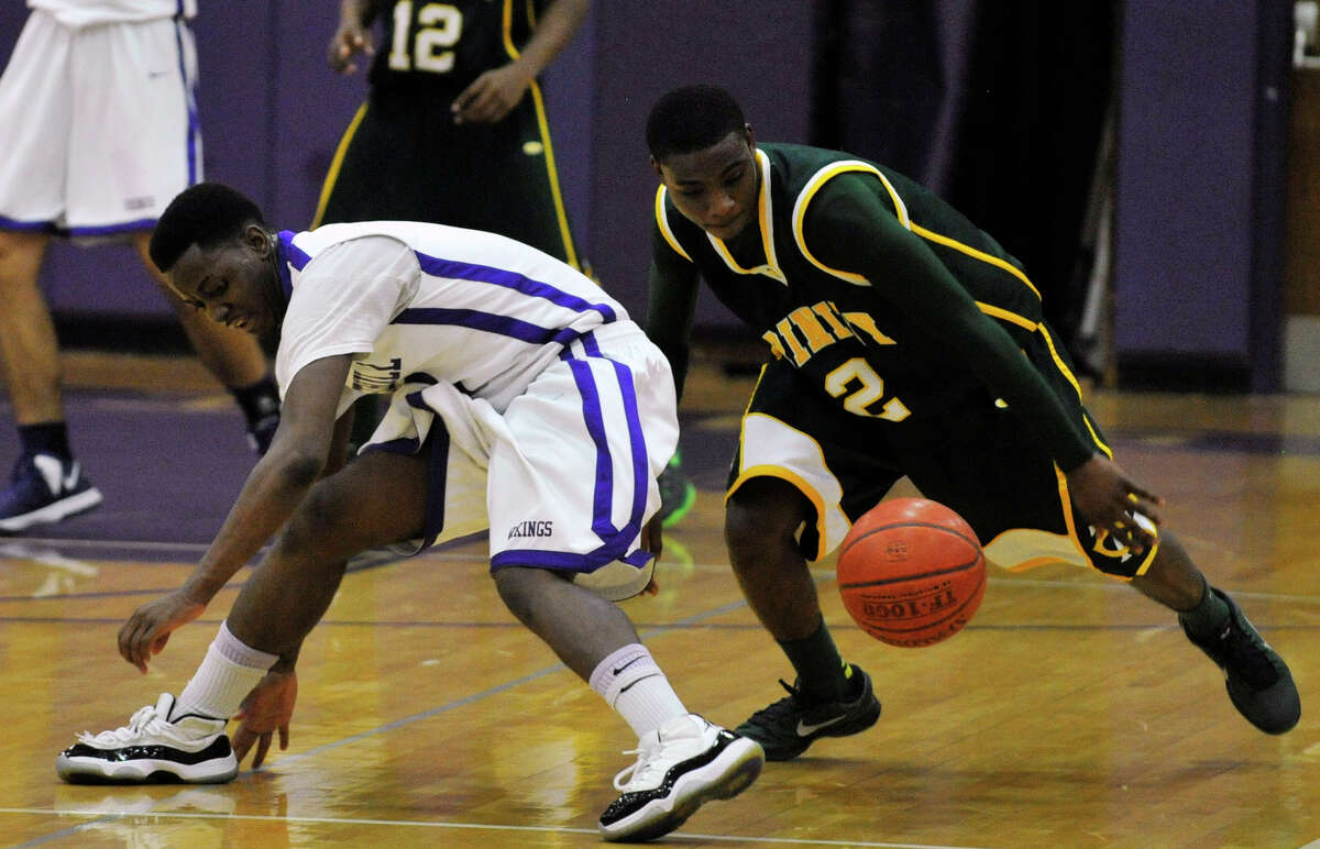 Trinity Catholic's Schadrac Casimir steals the ball from Westhill's Terrell Middleton during their City Championship game at Westhill High School in Stamford on Thursday, Feb. 14, 2013. Trinity Catholic won, 62-46.