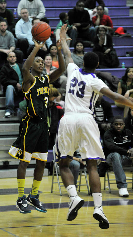 Trinity Catholic's Tremaine Fraiser shoots over Westhill's Ariel DelaCruz during their City Championship game at Westhill High School in Stamford on Thursday, Feb. 14, 2013. Trinity Catholic won, 62-46. Photo: Jason Rearick / The News-Times