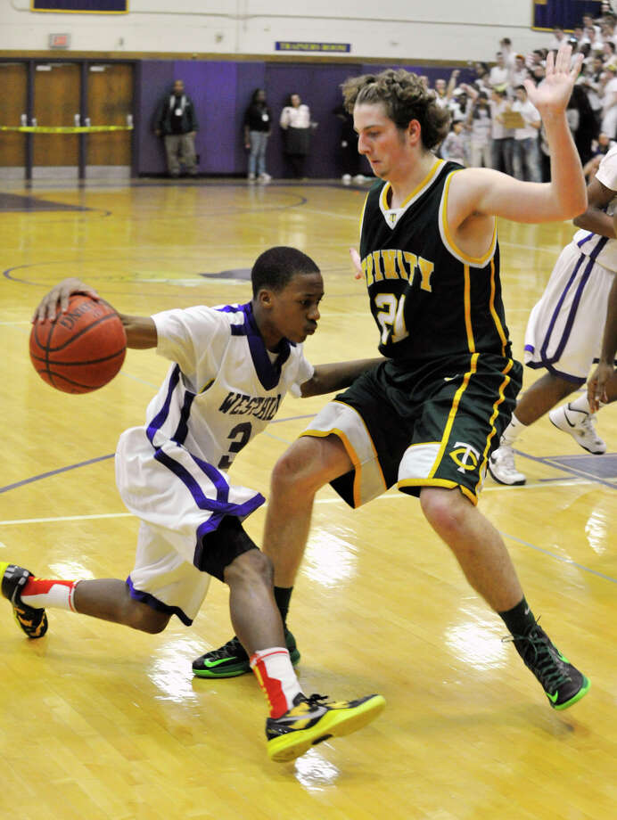 Westhill's CJ Donaldson is pressured by Trinity Catholic's Dan O'Leary during their City Championship game at Westhill High School in Stamford on Thursday, Feb. 14, 2013. Trinity Catholic won, 62-46. Photo: Jason Rearick / The News-Times