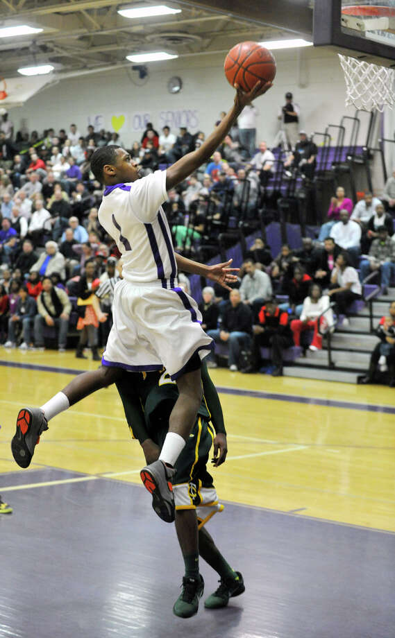 Westhill's Jeremiah Livingston lays the ball in uncontested during the Viking's game against Trinity Catholic in the City Championship game at Westhill High School in Stamford on Thursday, Feb. 14, 2013. Trinity Catholic won, 62-46. Photo: Jason Rearick / The News-Times
