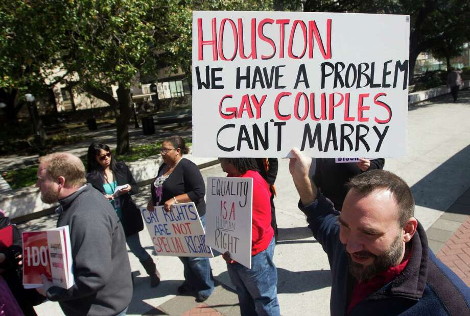 Darrin Brindle and close to a dozen same-sex couples march from the Harris County Clerk's office to Houston City Hall after being denied a marriage license on Thursday, Feb. 14, 2013, in Houston. Photo: J. Patric Schneider, For The Chronicle / © 2013 Houston Chronicle