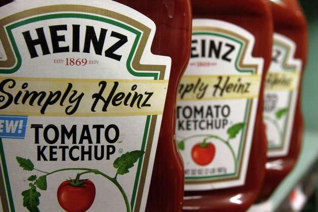 FILE - In this March 2, 2011 file photo, Heinz ketchup is seen on the shelf of a market in Barre, Vt. H.J. Heinz Co. says it agreed to be acquired by an investment consortium including billionaire investor Warren Buffett in a deal valued at $28 billion. (AP Photo/Toby Talbot, File) Photo: Toby Talbot