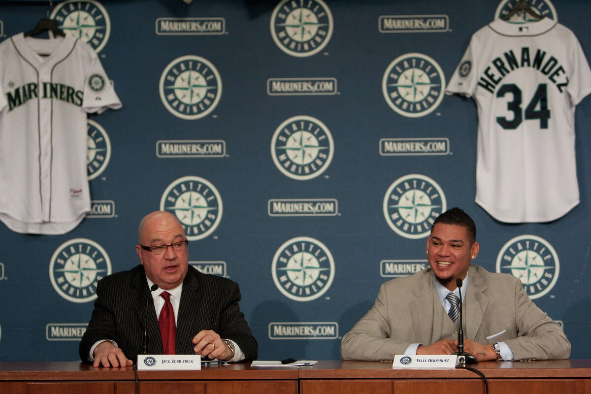 Seattle Mariners pitcher Felix Hernandez speaks as he signs a 7 year deal with Mariners General Manger Jack Zduriencik on Wednesday, February 13, 2013 at Safeco Field in Seattle.
