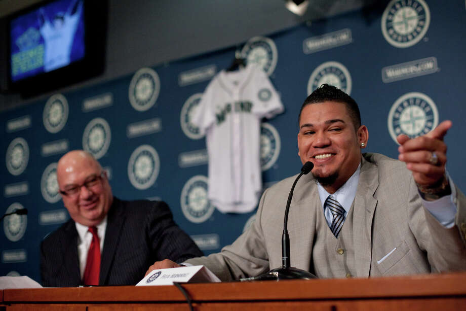 Seattle Mariners pitcher Felix Hernandez points toward his family as he signs a 7 year deal with Mariners General Manger Jack Zduriencik on Wednesday, February 13, 2013 at Safeco Field in Seattle. Photo: JOSHUA TRUJILLO, SEATTLEPI.COM / SEATTLEPI.COM