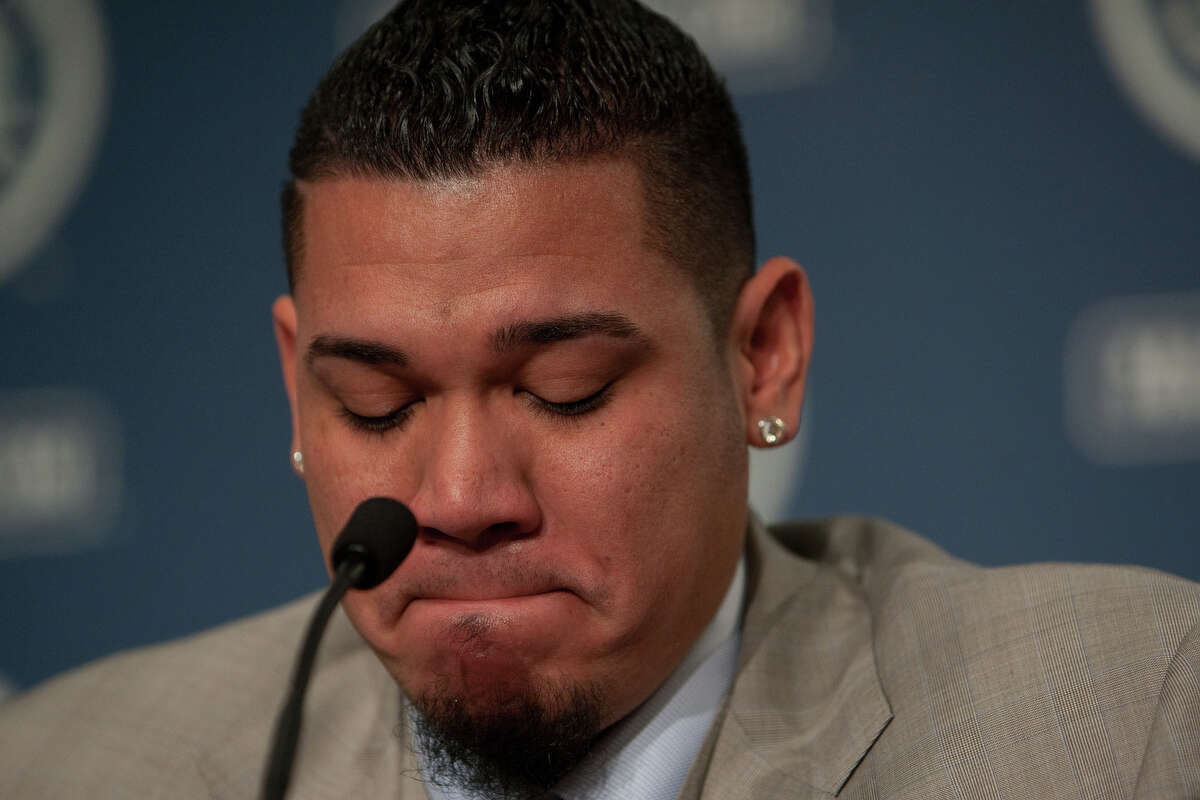 Seattle Mariners pitcher Felix Hernandez becomes emotional as he signs a 7 year deal with Mariners General Manger Jack Zduriencik on Wednesday, February 13, 2013 at Safeco Field in Seattle.