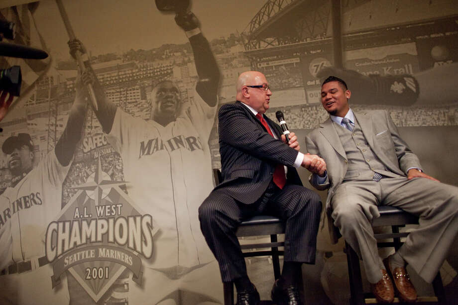 Seattle Mariners pitcher Felix Hernandez speaks with Mariners General Manger Jack Zduriencik after signing a contract on Wednesday, February 13, 2013 at Safeco Field in Seattle. Photo: JOSHUA TRUJILLO, SEATTLEPI.COM / SEATTLEPI.COM