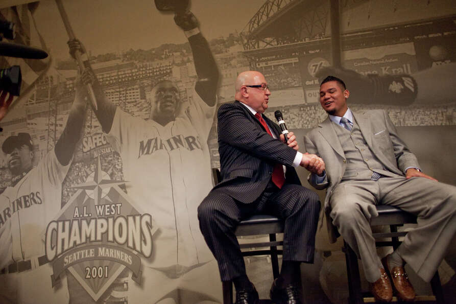 Seattle Mariners pitcher Felix Hernandez speaks with Mariners General Manger Jack Zduriencik after s