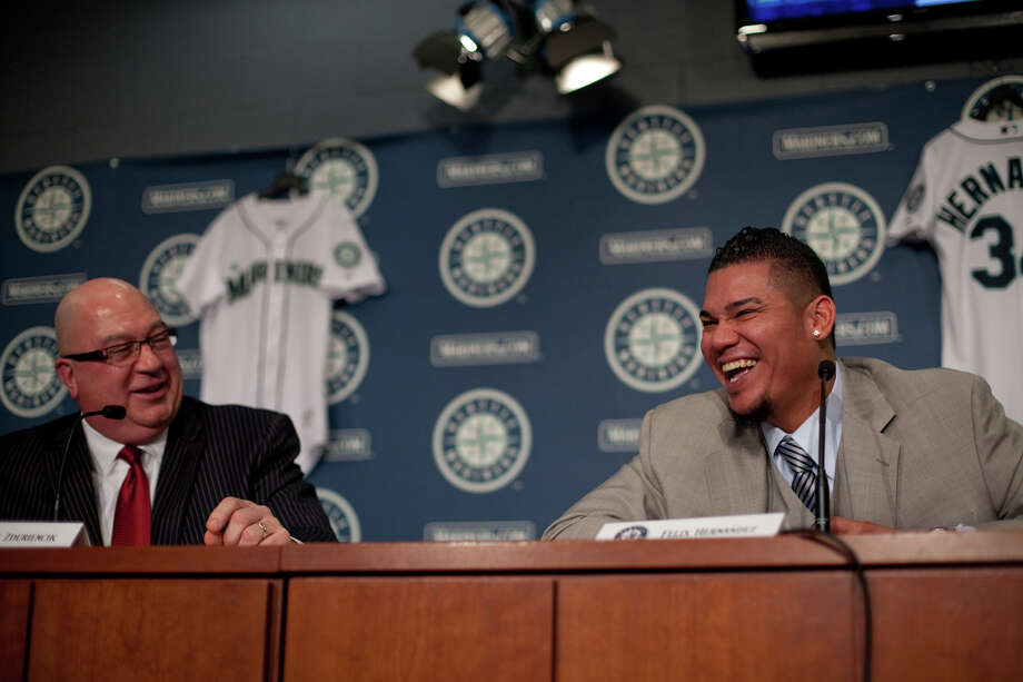 Seattle Mariners pitcher Felix Hernandez shares a light moment as he signs a 7 year deal with Mariners General Manger Jack Zduriencik on Wednesday, February 13, 2013 at Safeco Field in Seattle. Photo: JOSHUA TRUJILLO, SEATTLEPI.COM / SEATTLEPI.COM