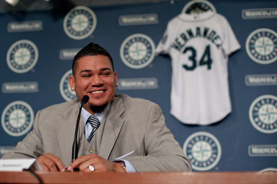 Seattle Mariners pitcher Felix Hernandez shares a light moment as he signs a 7 year deal with Marine