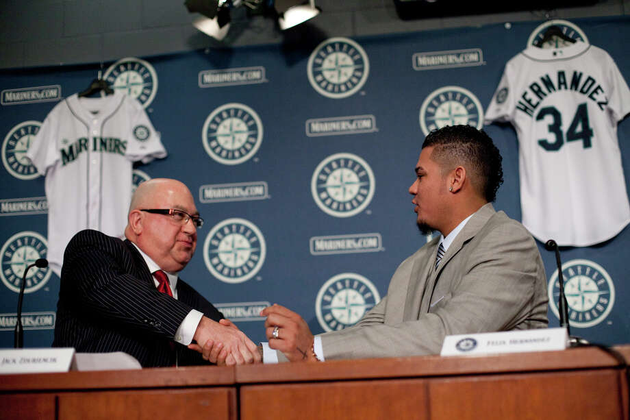 Seattle Mariners pitcher Felix Hernandez signs a 7 year deal with Mariners General Manger Jack Zduriencik on Wednesday, February 13, 2013 at Safeco Field in Seattle. Photo: JOSHUA TRUJILLO, SEATTLEPI.COM / SEATTLEPI.COM
