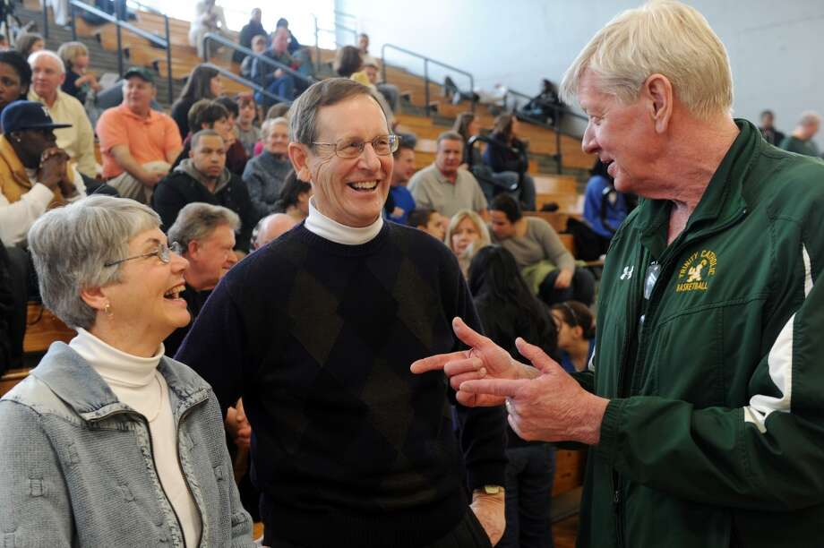 Frank and Sheila Beneski with Trinity Catholic coach Mike Walsh during last year's FCIAC Tournament.