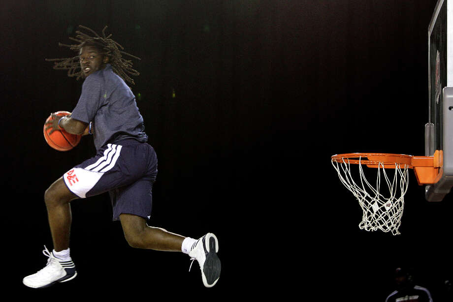 Javoris Carlisle of Atlanta takes to the air during performance by Air Elite, an acrobatic slam dunk team,  at the half-time of the All-Star Wheelchair Classic. Photo: Melissa Phillip, Houston Chronicle / © 2013 Houston Chronicle