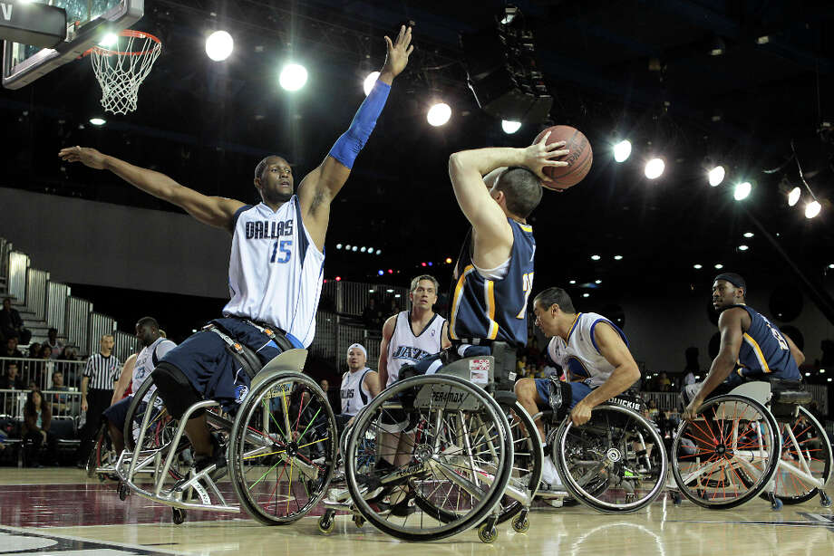 West All-Star Rodney Hawkins left, defends East All-Star Steve Serio right during the NWBA Wheelchair Classic All-Star Game. Photo: James Nielsen, Chronicle / © Houston Chronicle 2013