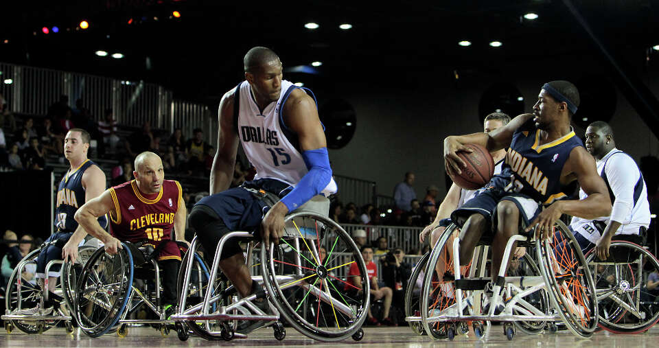East All-Star Brian Bell right, moves the ball during the NWBA Wheelchair Classic All-Star Game at t