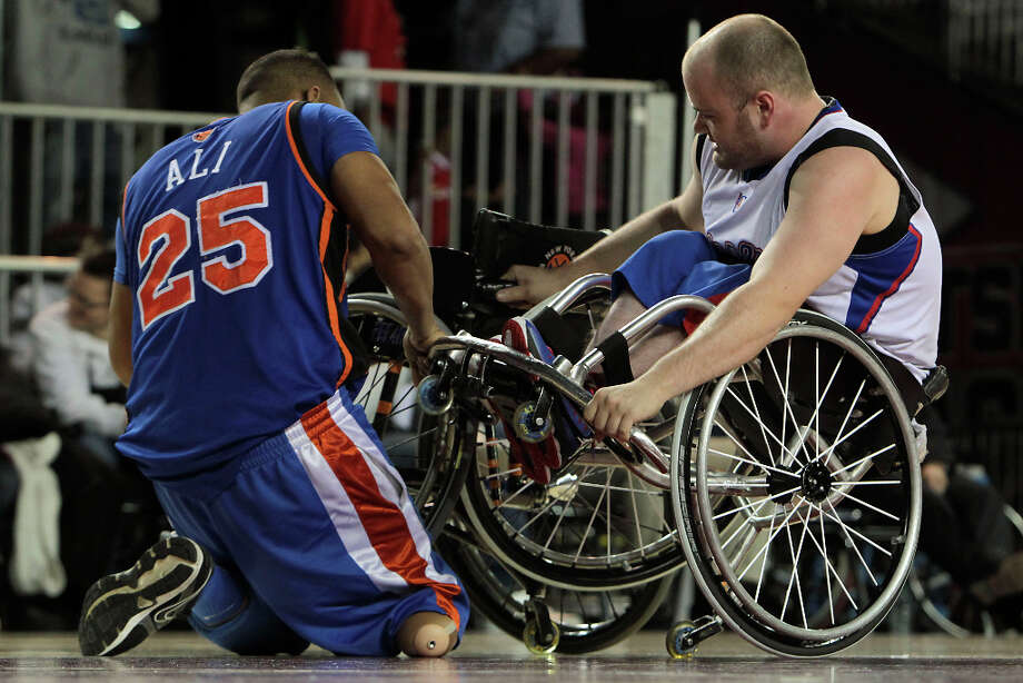 East All-Star Faizool Ali left, works to free a lodged wheel from West All-Star Alex Grunstein during the NWBA Wheelchair Classic All-Star Game. Photo: James Nielsen, Chronicle / © Houston Chronicle 2013