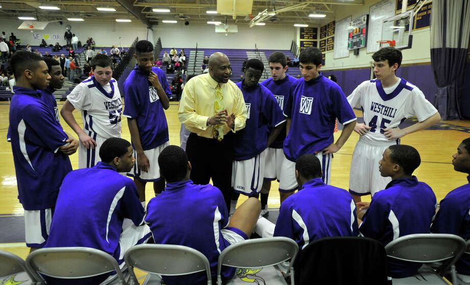 Westhill head coach Howard White talks to his team before the City Championship game against Westhill at Westhill High School in Stamford on Thursday, Feb. 14, 2013. Trinity Catholic won, 62-46. Photo: Jason Rearick / The News-Times