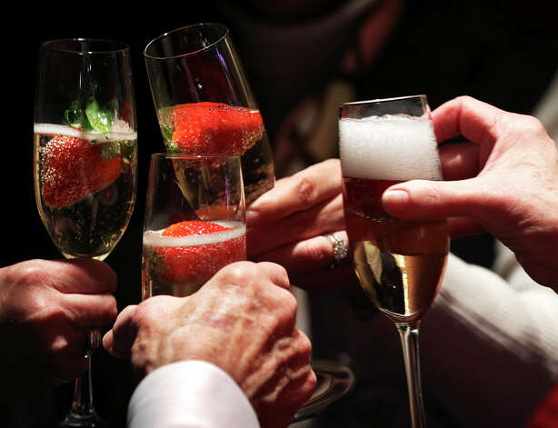 A toast is made as the rodeo hosts the Dust and Bubbles event for Valentines Day with champagne and food in a special suite for rodeo watchers on February 14, 2013. Photo: Tom Reel
