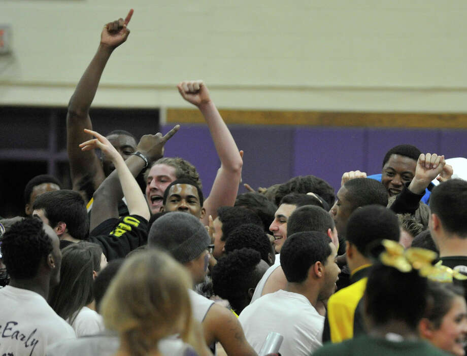 Trinity Catholic players and fans celebrate their 62-46 City Championship win over Westhill at Westhill High School in Stamford on Thursday, Feb. 14, 2013. Photo: Jason Rearick / The News-Times