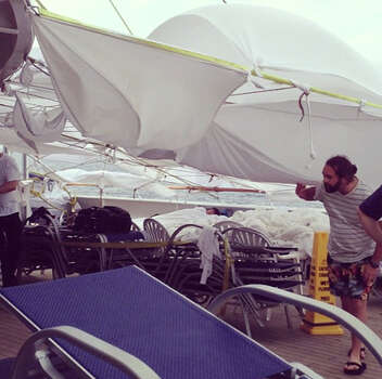 An Instagram photo provided by a passenger of the Triumph identifying himself as Clarkaj shows tents made of bed sheets on deck.  Photo: CLARKAJ, AFP/Getty Images / AFP