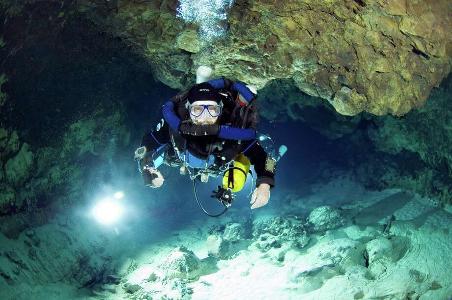 Texas A&M-Galveston professor Tom Iliffe is shown diving in the Canary Islands in 2008. Five years later, he explored an underwater cave in West Texas, the deepest such system in the United States. Photo: Jill Heinerth, Texas A&M Galveston / handout