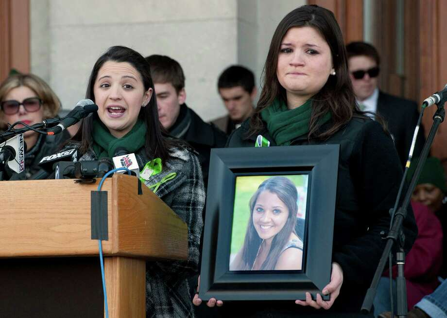 Jillian Soto, sister of Sandy Hook Elementary School shooting victim Victoria Soto, left, speaks as her cousin Heather Cronk, right, holding photograph of Soto, listens, during a rally at the Capitol in Hartford, Conn., Thursday, Feb. 14, 2013. Thousands of people turned out to call on lawmakers to toughen gun laws in light of the December elementary school shooting in Newtown that left 26 students and educators dead. Photo: Jessica Hill, AP Photo/Jessica Hill / Associated Press