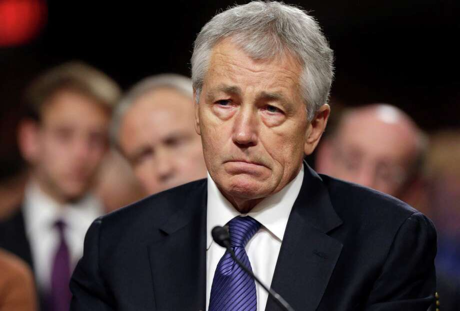 FILE - In this Jan. 31, 2013, file photo, Republican Chuck Hagel, President Obama's choice for Defense Secretary, testifies before the Senate Armed Services Committee during his confirmation hearing on Capitol Hill in Washington. Senate Republicans on Feb. 14, 2013, temporarily blocked a full Senate vote on Hagel's nomination as defense secretary.(AP Photo/J. Scott Applewhite, File) Photo: J. Scott Applewhite