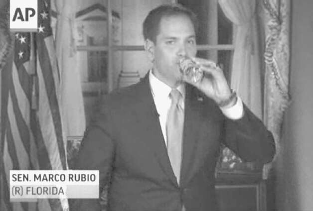 In this frame grab from video, Florida Sen. Marco Rubio takes a sip of water during his Republican response to President Barack Obama's State of the Union address, Tuesday, Feb. 12, 2013, in Washington. (AP Photo/Pool) Photo: Uncredited / Pool CBS