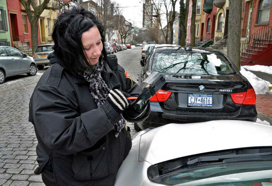 Albany City PSO Mindy Perez checks on cars parked along Jay Street Thursday Feb. 14, 2013.  (John Carl D'Annibale / Times Union) Photo: John Carl D'Annibale / 00021170A