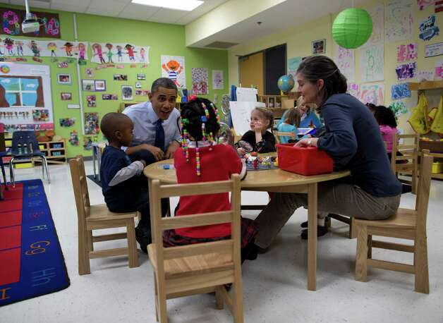 President Barack Obama visits a pre-kindergarten classroom at College Heights Early Childhood Learning Center in Decatur, Ga., Thursday, Feb. 14, 2013. The president is traveling to promote his economic and educational plan that he highlighted in his State of the Union address. (AP Photo/ Evan Vucci) Photo: Evan Vucci