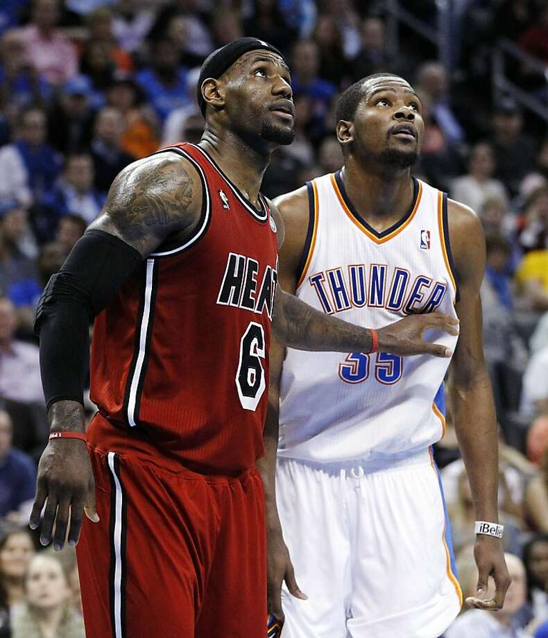 LeBron James (left) had 39 points, and Kevin Durant finished with 40. Photo: Sue Ogrocki, Associated Press