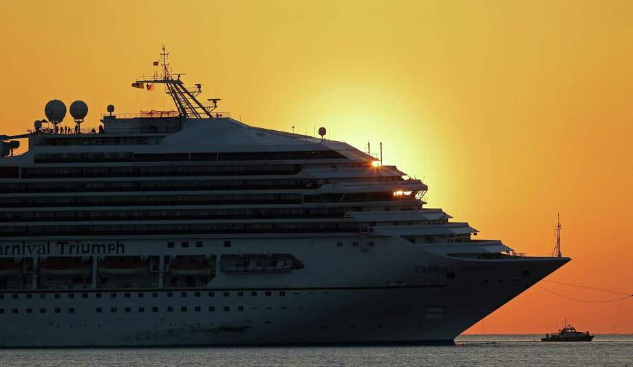 The cruise ship Carnival Triumph is towed into Mobile Bay near Dauphin Island, Ala., Thursday, Feb. 14, 2013. The ship with more than 4,200 passengers and crew members has been idled for nearly a week in the Gulf of Mexico following an engine room fire. (AP Photo/Dave Martin) Photo: Dave Martin
