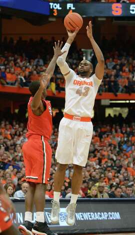 Syracuse's James Southerland shoots over St. John's Phil Greene during the second half of an NCAA college basketball game in Syracuse, N.Y., Sunday, Feb. 10, 2013. Syracuse won 77-58. (AP Photo/Kevin Rivoli) Photo: Kevin Rivoli