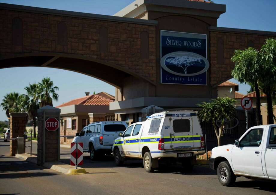 A police vehicle enters the housing estate where Olympian Oscar Pistorius lives, in Pretoria, South Africa, Thursday, Feb. 14, 2013. Reports say that a 30-year-old woman was shot dead at Pistorius's home earlier after being mistaken for an intruder. (AP Photo/Str) Photo: Str