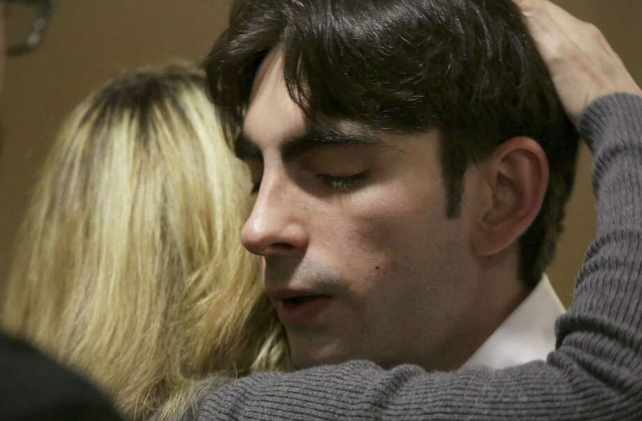 """Robert """"Sam"""" Stinziano gets a hug from friend Rhonda Campanella after he took the stand in his intoxication manslaughter trial. Since his car was deemed a deadly weapon, he'll have to serve at least half his sentence. Photo: Photos By Bob Owen / San Antonio Express-News"""