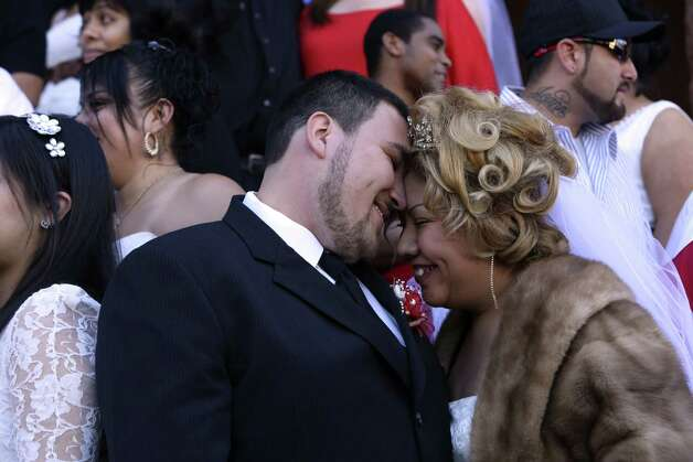 Jose A. Rivas and Suri Zuniga were among the couples who got married on the steps of the Bexar County Courthouse on Valentine's Day. Photo: Helen L. Montoya / San Antonio Express-News