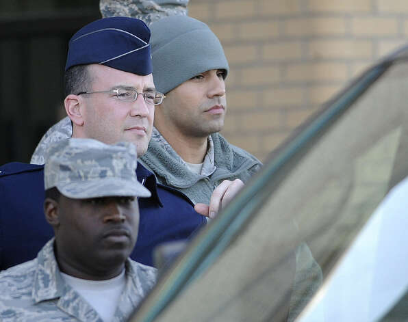 Air Force Staff Sgt. Craig LeBlanc (right) is led from a Joint Base San Antonio-Lackland courtroom after being sentenced. Photo: Billy Calzada / San Antonio Express-News