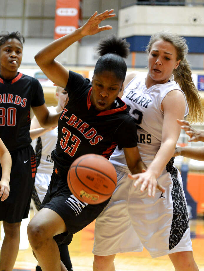 Kaelynn Wilson (33) of Wagner and Kristen Lye (22) of Clark jostle for a loose ball during the Thunderbirds' 73-56 second-round victory Thursday. Photo: John Albright / Special To The Express-News