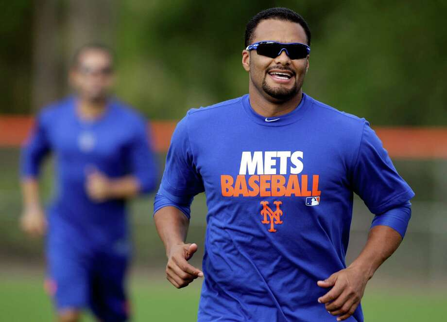 New York Mets starting pitcher Johan Santana jogs during the team's first pitchers and catchers workout at spring training baseball, Wednesday, Feb. 13, 2013, in Port St. Lucie, Fla. (AP Photo/Julio Cortez) Photo: Julio Cortez
