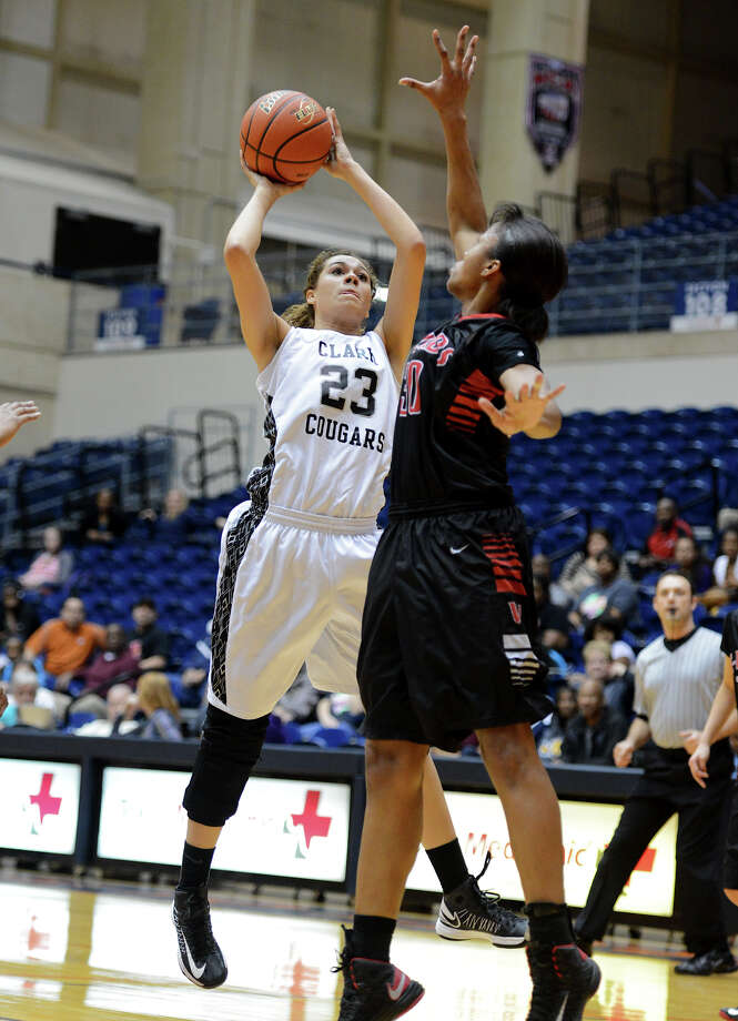 Clark's Alejandra Esparza-Raglin (23) takes a shot during a 5A girls second round playoff basketball game between the Wagner Thunderbirds and the Clark Cougars at the UTSA Convocation Center, Thursday, February 14, 2013. 