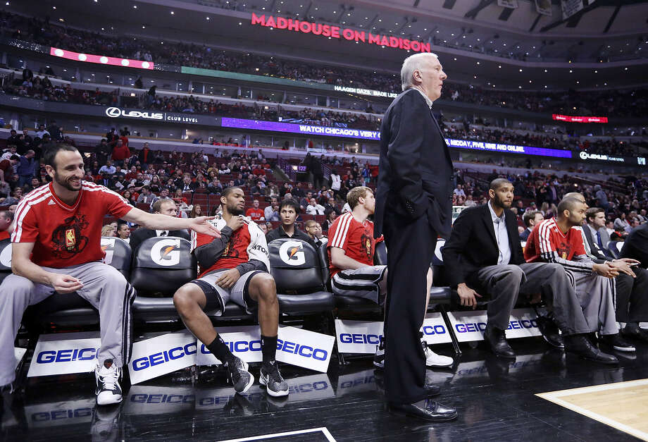 The Spurs were without Manu Ginobili (left), Tim Duncan (second from right) and Tony Parker (right) Monday in Chicago, but they still had coach Gregg Popovich, who guided his star-less squad to victory anyway. Photo: Edward A. Ornelas / San Antonio Express-News