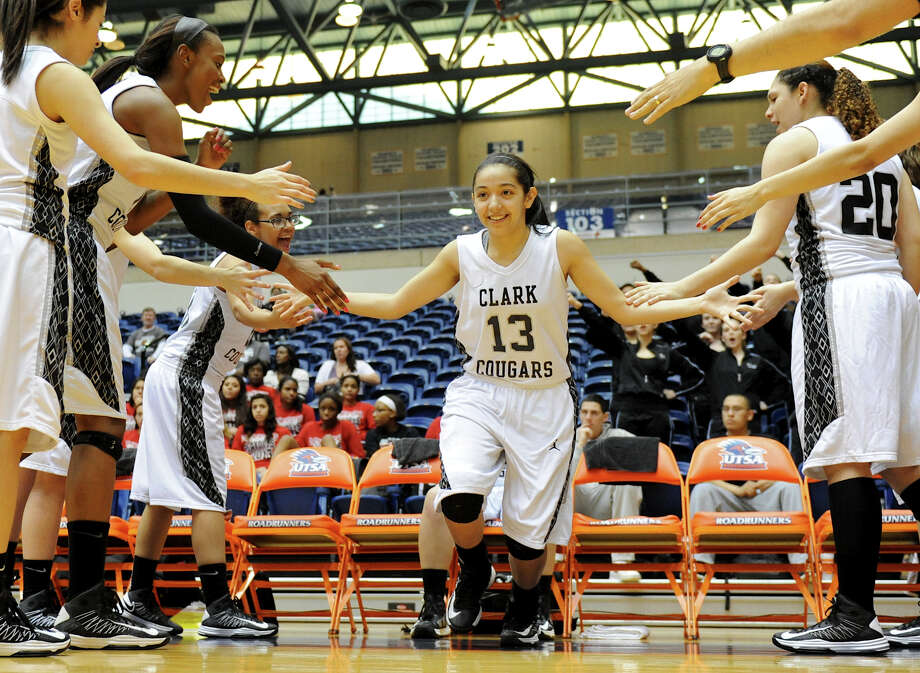 Clark senior Mercedes Orozco (13) is introduced before a 5A girls second round playoff basketball game between the Wagner Thunderbirds and the Clark Cougars at the UTSA Convocation Center, Thursday, February 14, 2013.  John Albright / Special to the Express-News. Photo: JOHN ALBRIGHT, San Antonio Express-News / San Antonio Express-News