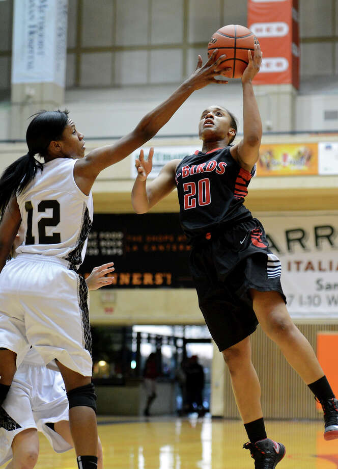 Wagner's Ashley Ross (20) has her shot blocked by Clark's D'onna Matthews (12)  during a 5A girls second round playoff basketball game between the Wagner Thunderbirds and the Clark Cougars at the UTSA Convocation Center, Thursday, February 14, 2013. 